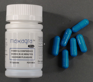 Maxagra bottle and capsules