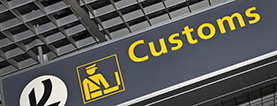 sign reading customs at airport