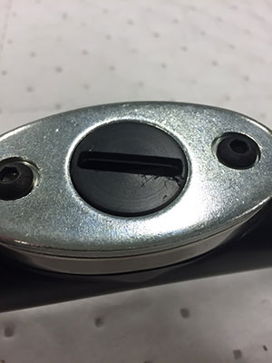 A 'puck' with a damaged plastic swivel. Look for any form of crack or divot or unusual widening of the opening.