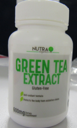 Bottle of Nutra Organics Green Tea Extract capsules.  Front view.
